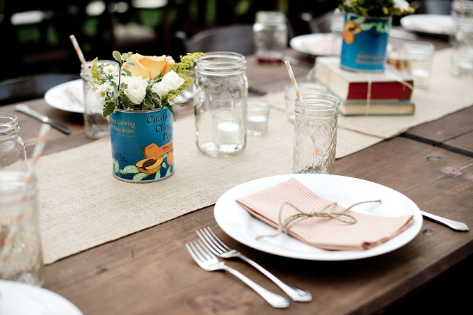 Leave the complications out of designing your dining tables. A little burlap goes a long way, especially when it's combined with antique items, like books and tin cans.