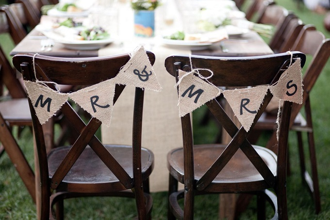 """Stake your claim as the new """"Mr. & Mrs."""" with one of our custom made burlap banners that can be doubled as chair markers."""
