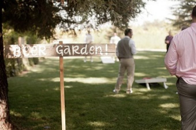"""Gathering up all the 21 and over party guests is an easy task when you use one of our homemade """"Beer Garden"""" signs."""