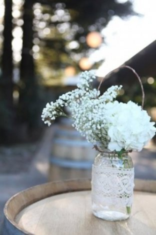 Hanging mason jars (with or without the antique lace trimming) add character to your wedding's surroundings. Hang them from nearby tree branches, down your matrimonial aisle, or simply place them around your wedding venue for a classy take on a vintage look.