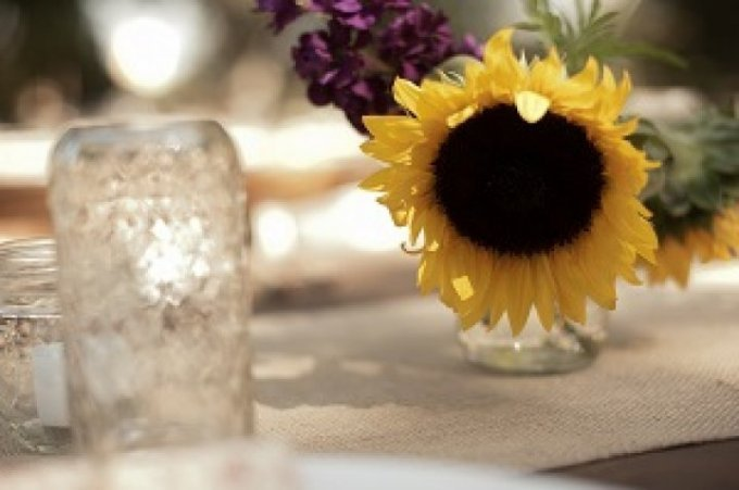 The mason jar is a universal symbol to any country chic wedding. Use them as your drinking glass, candle holder, or vase.