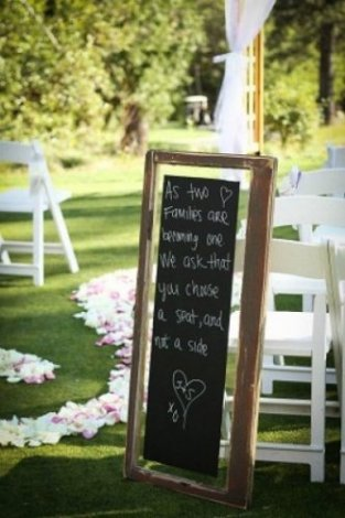 Tradition doesn't have to dictate where your family and friends sit when they watch you and your betrothed become husband and wife. One of our vintage chalk board window signs is an easy way to let everyone know that they are welcome to sit anywhere they'd like.