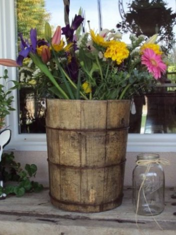 If an area of your wedding needs an extra push towards appearing antique, we suggest using one of our large wooden buckets filled with long-stem flowers of your choice.